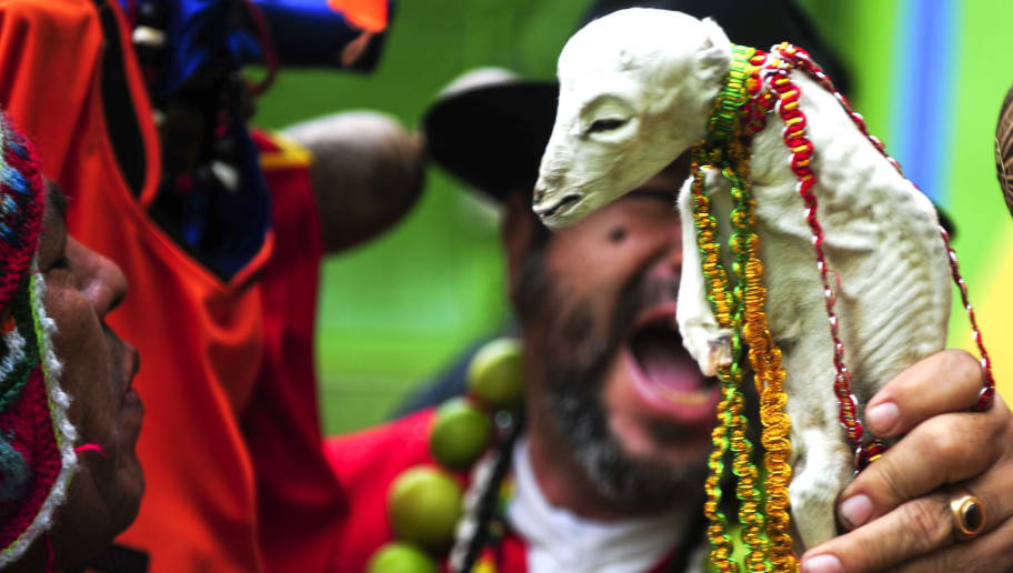 A shaman uses a sheep foetus during a ritual of predictions for the 2010 World Cup finals, in Lima, on July 09, 2010. AFP PHOTO/ERNESTO BENAVIDES (Photo credit should read ERNESTO BENAVIDES/AFP/Getty Images)