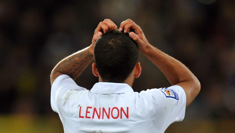 Aaron Lennon of England reacts after the