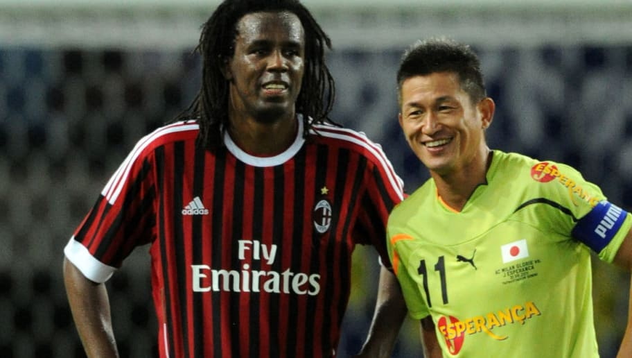 SENDAI, JAPAN - AUGUST 31:  Kazuyoshi Miura of J Esperanca and Roque Junior of AC Milan Glorie talk during the Earthquake Charity match between AC Milan Glorie and J Esperanca at Yurtec Stadium Sendai on August 31, 2011 in Sendai, Miyagi, Japan.  (Photo by Etsuo Hara/Getty Images)