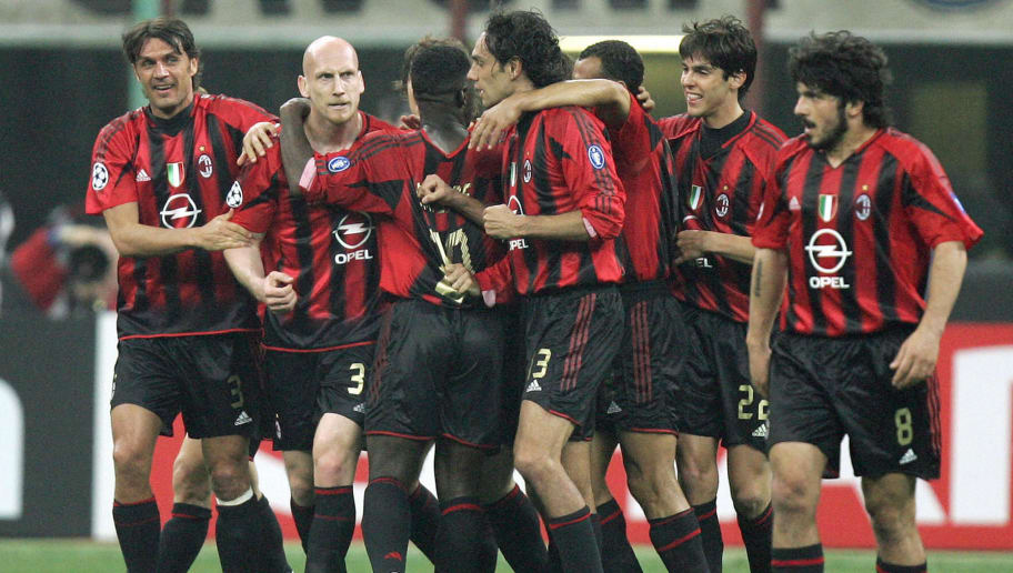 AC Milan's defender Jaap Stam (2ndL) his