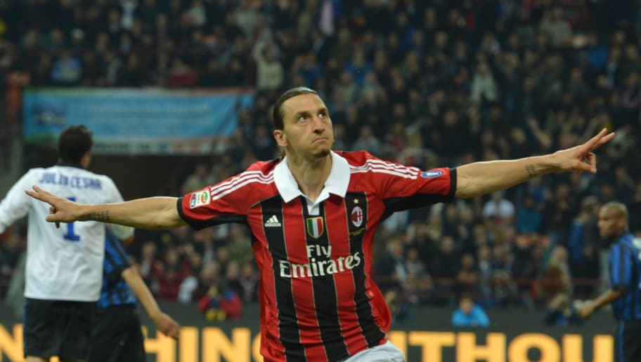 AC Milan's Swedish forward Zlatan Ibrahimovic celebrates after scoring   during their  Serie A football match between Inter Milan and AC Milan at San Siro Stadium in Milan  on May 06, 2012. AFP PHOTO / GIUSEPPE CACACE        (Photo credit should read GIUSEPPE CACACE/AFP/GettyImages)