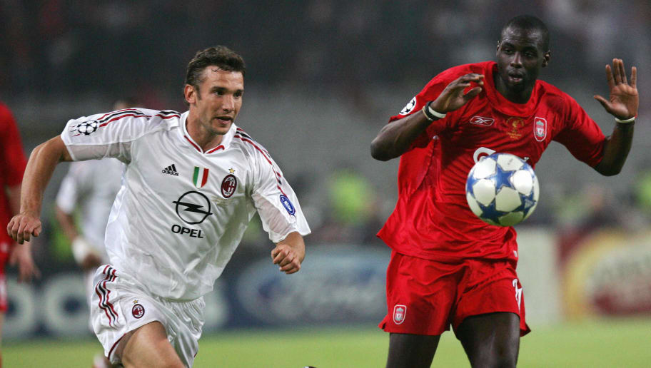 ISTANBUL, Turkey:  AC Milan's Ukrainian forward Andriy Shevchenko (L) fights for the ball with Liverpool's French defender Djimi Traore during the UEFA Champions League football final AC Milan Liverpool, 25 May 2005 at the Ataturk stadium in Istanbul. AFP PHOTO TARIK TINAZAY  (Photo credit should read TARIK TINAZAY/AFP/Getty Images)