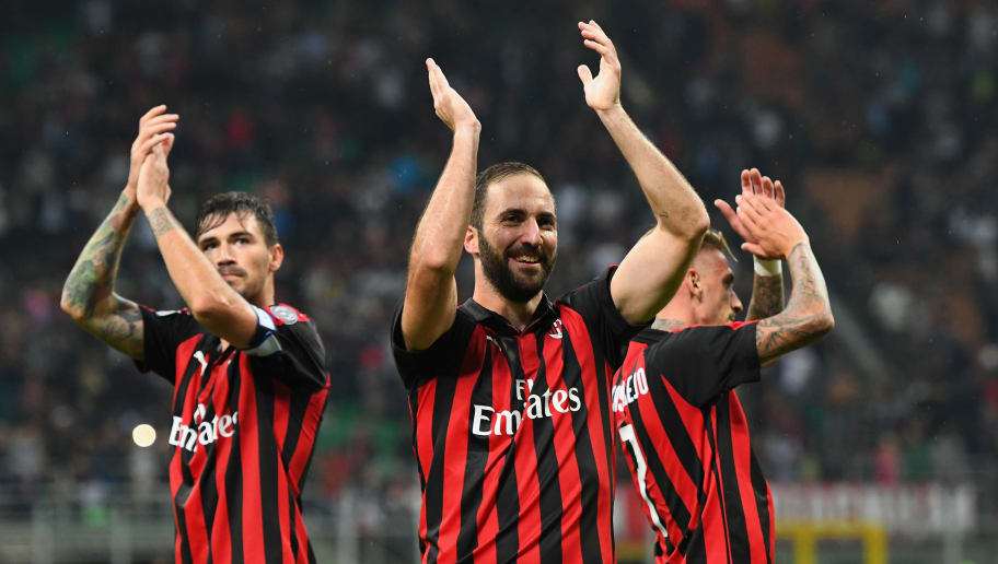 MILAN, ITALY - AUGUST 31:  Gonzalo Higuain of AC Milan celebrates the victory after the serie A match between AC Milan and AS Roma at Stadio Giuseppe Meazza on August 31, 2018 in Milan, Italy.  (Photo by Alessandro Sabattini/Getty Images)