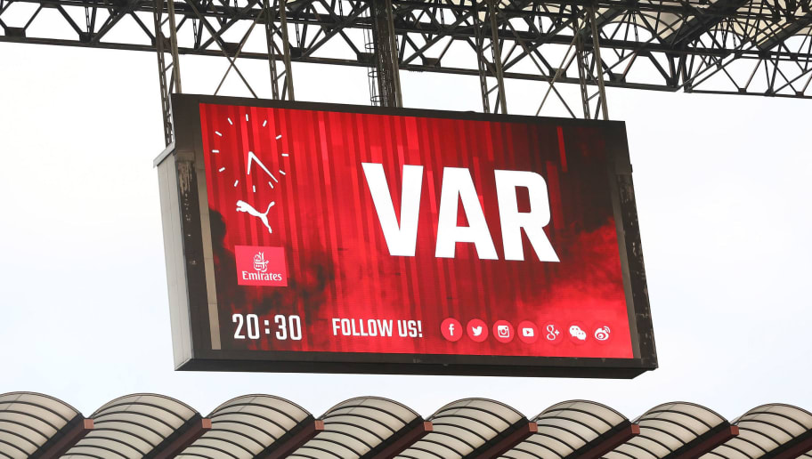 MILAN, ITALY - SEPTEMBER 23:  The maxi screen shows the use of var during the serie A match between AC Milan and Atalanta BC at Stadio Giuseppe Meazza on September 23, 2018 in Milan, Italy.  (Photo by Marco Luzzani/Getty Images)