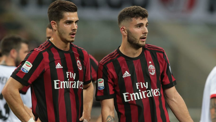 MILAN, ITALY - APRIL 21:  Patrick Cutrone (R) and Andre Silva of AC Milan look on during the serie A match between AC Milan and Benevento Calcio at Stadio Giuseppe Meazza on April 21, 2018 in Milan, Italy.  (Photo by Emilio Andreoli/Getty Images)