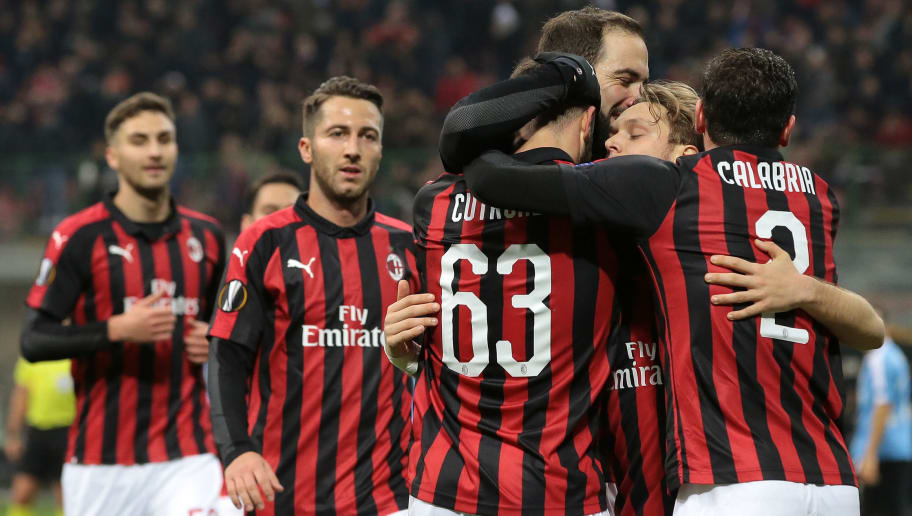MILAN, ITALY - NOVEMBER 29:  Patrick Cutrone of AC Milan celebrates with his team-mates after scoring the opening goal during the UEFA Europa League Group F match between AC Milan and F91 Dudelange at Stadio Giuseppe Meazza on November 29, 2018 in Milan, Italy.  (Photo by Emilio Andreoli/Getty Images)