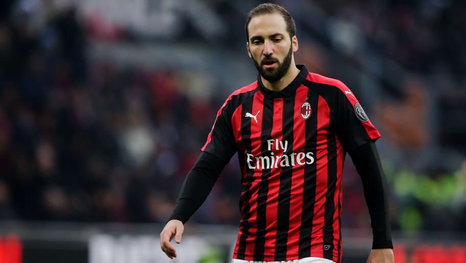 MILAN, ITALY - DECEMBER 22: Gonzalo Higuain of AC Milan during the Italian Serie A   match between AC Milan v Fiorentina at the San Siro on December 22, 2018 in Milan Italy (Photo by Erwin Spek/Soccrates/Getty Images)