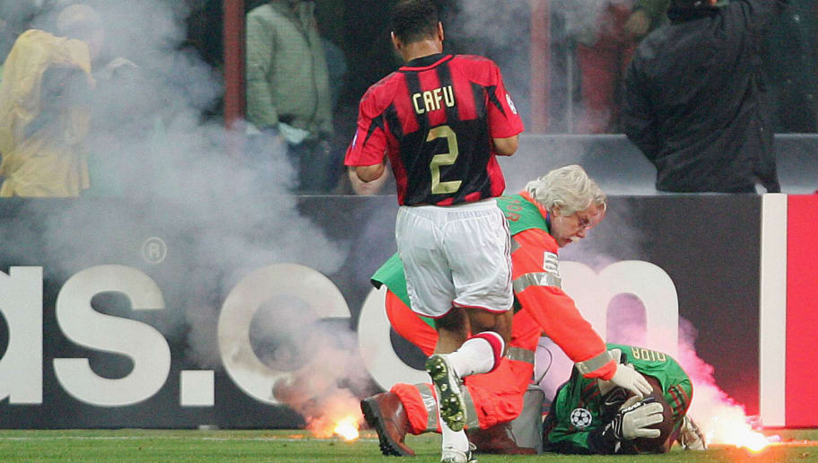 MILAN, ITALY -  APRIL 12:  AC Milan goalkeeper Dida is struck by a flare during the UEFA Champions League quarter-final second leg between AC Milan and Inter Milan at the San Siro Stadium on April 12, 2005  in Milan, Italy. (Photo by Mike Hewitt/Getty Images)