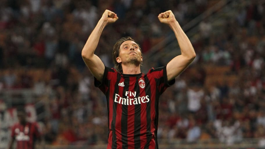 MILAN, ITALY - AUGUST 17:  Riccardo Montolivo of AC Milan celebrates his second goal during the UEFA Europa League Qualifying Play-Offs round first leg match between AC Milan and KF Shkendija 79 at Stadio Giuseppe Meazza on August 17, 2017 in Milan, Italy.  (Photo by Marco Luzzani/Getty Images)