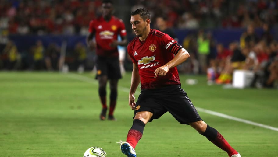 CARSON, CA - JULY 25:  Matteo Darmian  #36 of Manchester United plays the ball forward during the first half of the International Champions Cup 2018 match against AC Milan at StubHub Center on July 25, 2018 in Carson, California. Manchester United defeated AC Milan 9-8 on penalties after playing to a 1-1 regulation draw.  (Photo by Victor Decolongon/Getty Images)