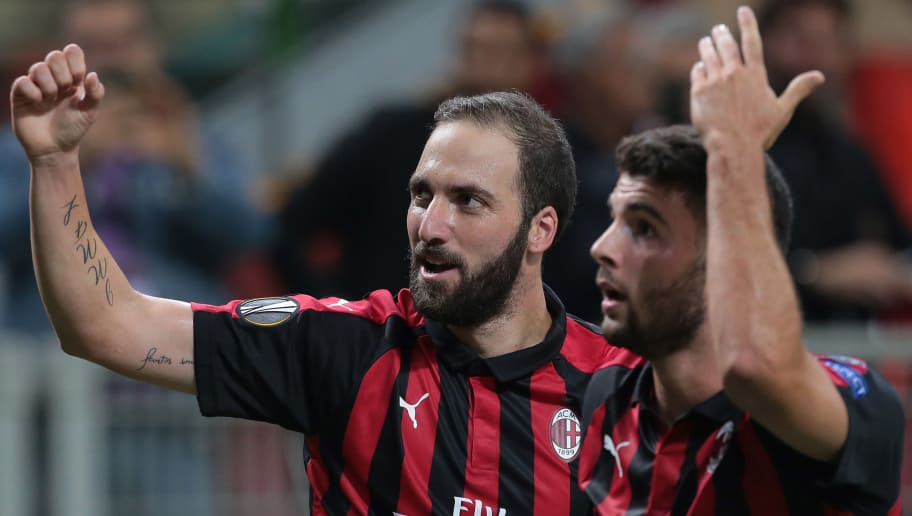 MILAN, ITALY - OCTOBER 04:  Gonzalo Higuain (L) of AC Milan celebrates his goal with his team-mate Patrick Cutrone during the UEFA Europa League Group F match between AC Milan and Olympiacos at Stadio Giuseppe Meazza on October 4, 2018 in Milan, Italy.  (Photo by Emilio Andreoli/Getty Images)