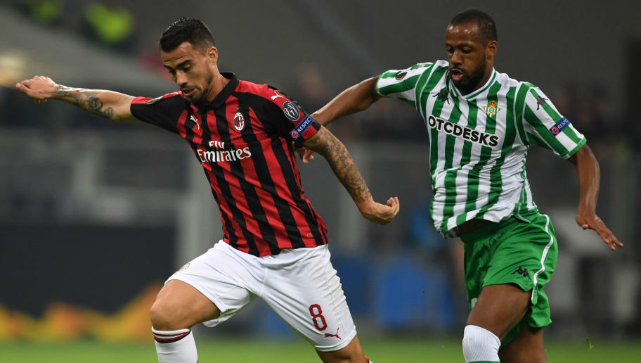 Suso of Milan (L) and Sidnei of Betis compete for the ball during the UEFA Europa League Group F match between AC Milan and Real Betis at Stadio Giuseppe Meazza on October 25, 2018 in Milan, Italy. (Photo by Etsuo Hara/Getty Images)