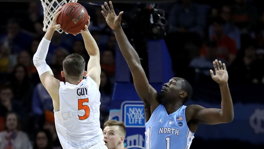 NEW YORK, NY - MARCH 10: Kyle Guy #5 of the Virginia Cavaliers takes a shot against Theo Pinson #1 of the North Carolina Tar Heels in the first half during the championship game of the 2018 ACC Men's Basketball Tournament at Barclays Center on March 10, 2018 in the Brooklyn borough of New York City.  (Photo by Abbie Parr/Getty Images)