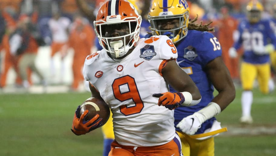 CHARLOTTE, NC - DECEMBER 01:  Travis Etienne #9 of the Clemson Tigers runs for a touchdown against the Pittsburgh Panthers in the first quarter during their game at Bank of America Stadium on December 1, 2018 in Charlotte, North Carolina.  (Photo by Streeter Lecka/Getty Images)
