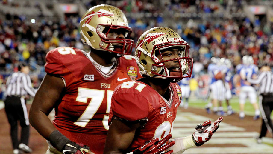 CHARLOTTE, NC - DECEMBER 07: Wide receiver Kenny Shaw #81 and offensive linesman Cameron Erving #75 of the Florida State Seminoles celebrate against the Duke Blue Devils during the ACC Championship game at Bank of America Stadium on December 7, 2013 in Charlotte, North Carolina.  (Photo by Streeter Lecka/Getty Images)