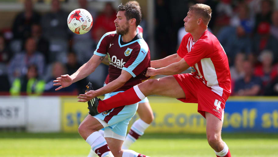 ACCRINGTON, ENGLAND - JULY 18:  Lukas Jutkiewicz of Burnley shields the ball from Tom Davies of Accrington Stanley during a Pre Season Friendly match between Accrington Stanley and Burnley at The Store First Stadium on July 18, 2015 in Accrington, England.  (Photo by Alex Livesey/Getty Images)