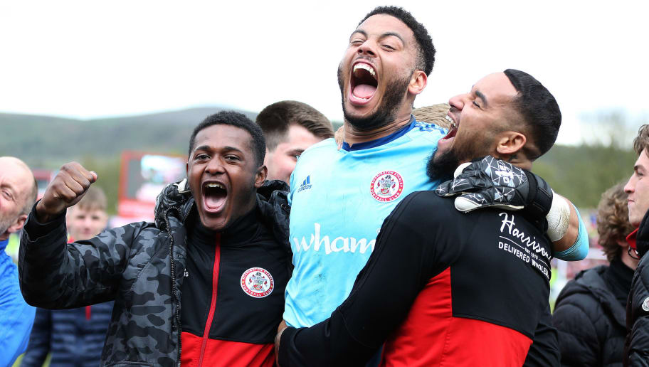 ACCRINGTON, ENGLAND - APRIL 28:  Accrington Stanley players and staff celebrate after winning the league afer the Sky Bet League Two match between Accrington Stanley and Lincoln City at The Crown Ground on April 28, 2018 in Accrington, England. (Photo by Nigel Roddis/Getty Images)