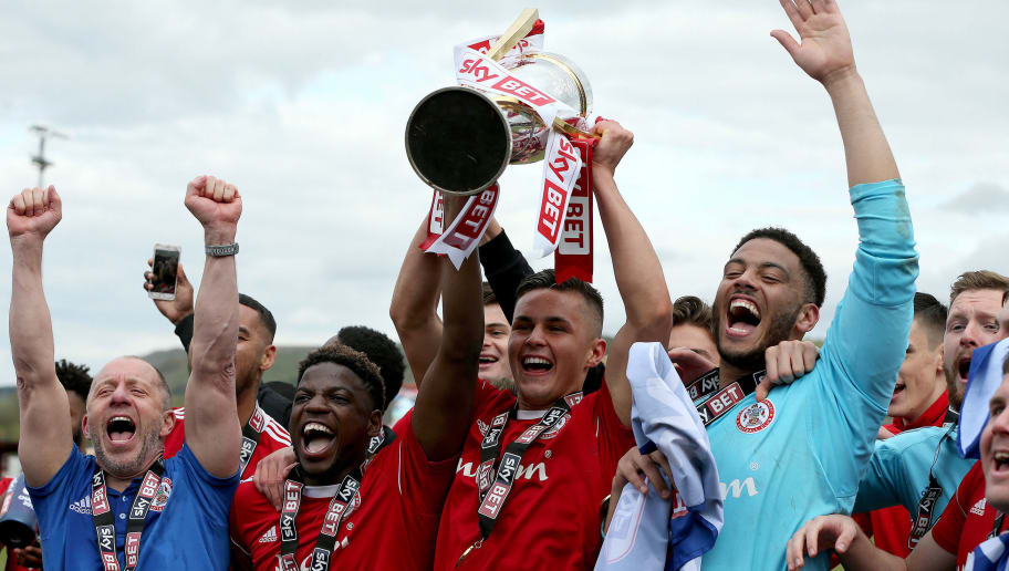 ACCRINGTON, ENGLAND - APRIL 28:  Accrington Stanley players and staff celebrate after winning the league after the Sky Bet League Two match between Accrington Stanley and Lincoln City at The Crown Ground on April 28, 2018 in Accrington, England. (Photo by Nigel Roddis/Getty Images)
