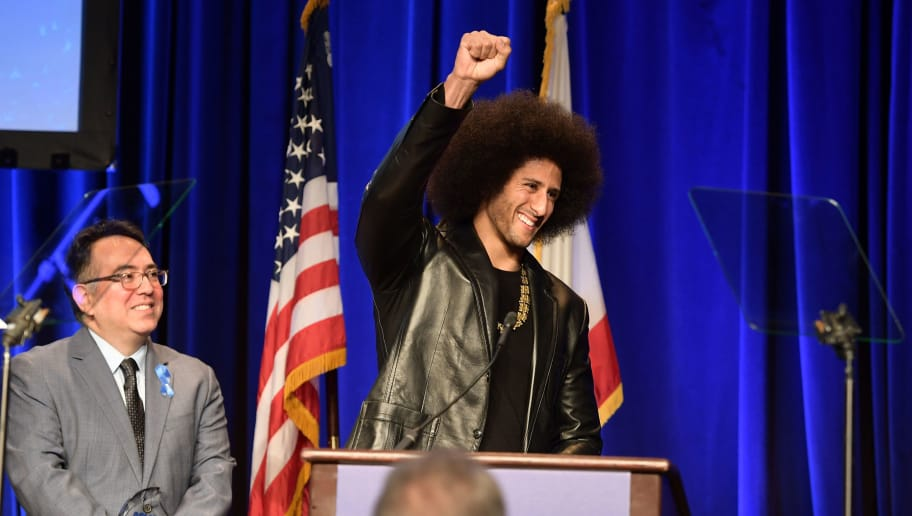 BEVERLY HILLS, CA - DECEMBER 03:  Hector Villagra, executive director at ACLU Southern California, and honoree Colin Kaepernick onstage at ACLU SoCal Hosts Annual Bill of Rights Dinner at the Beverly Wilshire Four Seasons Hotel on December 3, 2017 in Beverly Hills, California.  (Photo by Matt Winkelmeyer/Getty Images)