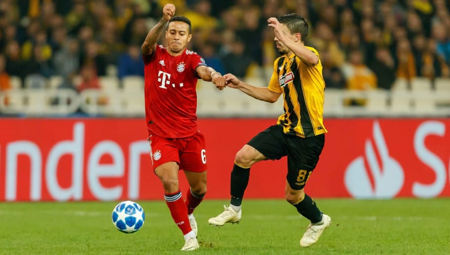 ATHENS, GREECE - OCTOBER 23: Thiago Alcantara of Bayern Muenchen and Andre Simoes of AEK Athens battle for the ball during the UEFA Champions League Group E match between AEK Athens and FC Bayern Muenchen at Athens Olympic Stadium on October 23, 2018 in Athens, Greece. (Photo by TF-Images/Getty Images)