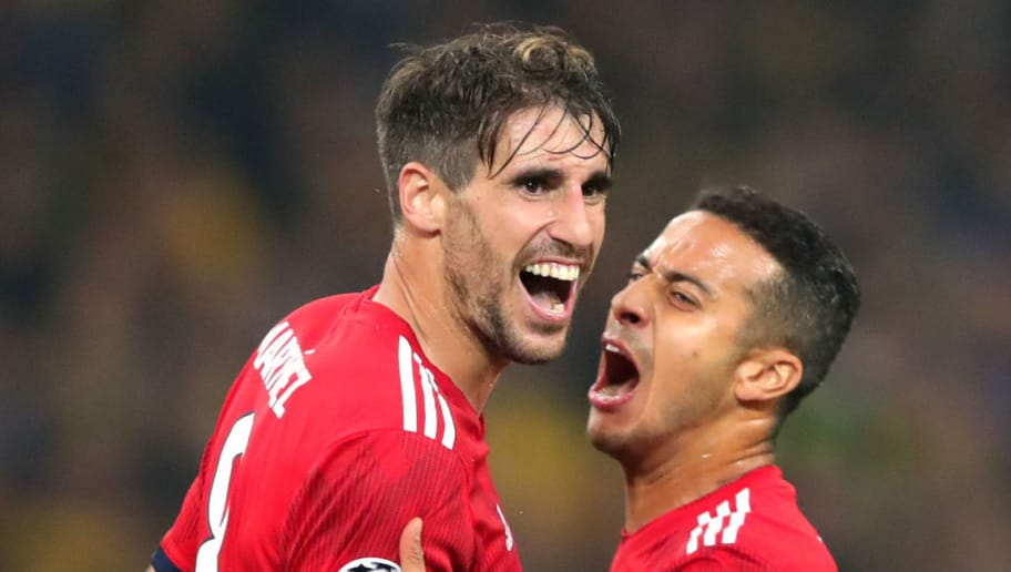 ATHENS, GREECE - OCTOBER 23:  Javier Martinez of Bayern Munich celebrates after scoring his team's first goal with Thiago Alcantara during the Group E match of the UEFA Champions League between AEK Athens and FC Bayern Muenchen at Athens Olympic Stadium on October 23, 2018 in Athens, Greece.  (Photo by Alexander Hassenstein/Bongarts/Getty Images)
