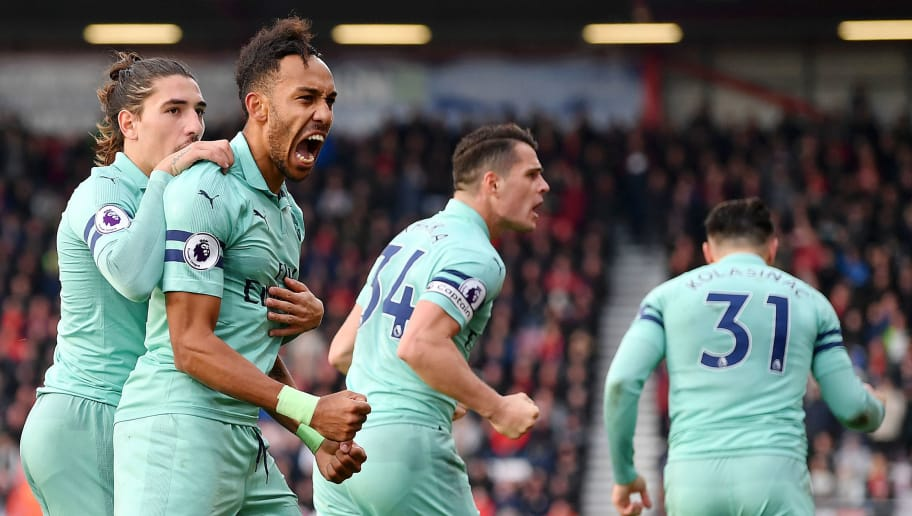 BOURNEMOUTH, ENGLAND - NOVEMBER 25:  Pierre-Emerick Aubameyang of Arsenal celebrates after scoring his team's second goal with Hector Bellerin during the Premier League match between AFC Bournemouth and Arsenal FC at Vitality Stadium on November 25, 2018 in Bournemouth, United Kingdom.  (Photo by Dan Mullan/Getty Images)