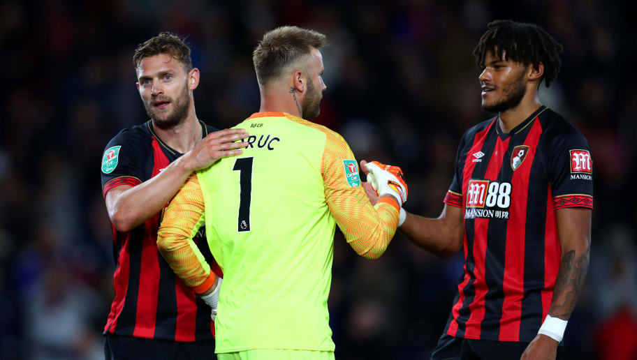 BOURNEMOUTH, ENGLAND - SEPTEMBER 25:  Simon Francis of Bournemouth celebrates victory with Artur Boruc and Tyrone Mings after the Carabao Cup Third Round match between AFC Bournemouth and Blackburn Rovers at Vitality Stadium on September 25, 2018 in Bournemouth, England.  (Photo by Dan Istitene/Getty Images)