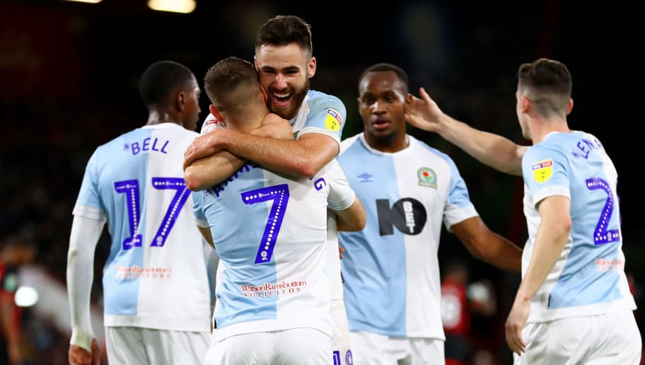 BOURNEMOUTH, ENGLAND - SEPTEMBER 25:  Adam Armstrong of Blackburn Rovers celebrates with team-mates after scoring his team's second goal from the penalty spot during the Carabao Cup Third Round match between AFC Bournemouth and Blackburn Rovers at Vitality Stadium on September 25, 2018 in Bournemouth, England.  (Photo by Dan Istitene/Getty Images)