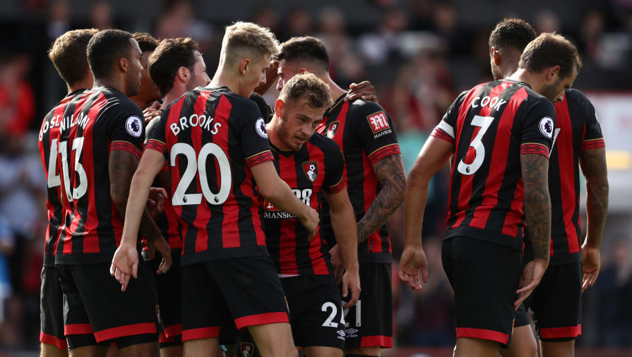 BOURNEMOUTH, ENGLAND - SEPTEMBER 15:  Ryan Fraser of AFC Bournemouth celebrates with teammates after scoring his team's second goal during the Premier League match between AFC Bournemouth and Leicester City at Vitality Stadium on September 15, 2018 in Bournemouth, United Kingdom.  (Photo by Bryn Lennon/Getty Images,)