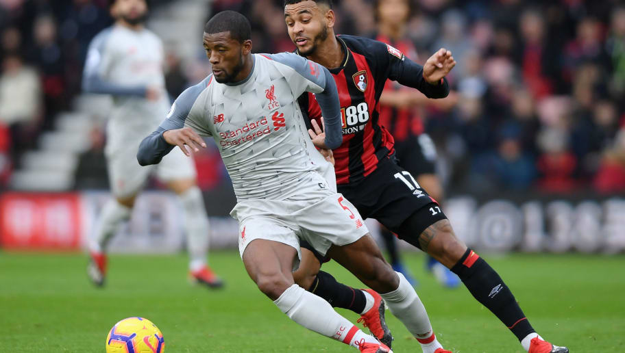 BOURNEMOUTH, ENGLAND - DECEMBER 08: Georginio Wijnaldum of Liverpool is challenged by Joshua King of AFC Bournemouth during the Premier League match between AFC Bournemouth and Liverpool FC at Vitality Stadium on December 8, 2018 in Bournemouth, United Kingdom.  (Photo by Mike Hewitt/Getty Images)
