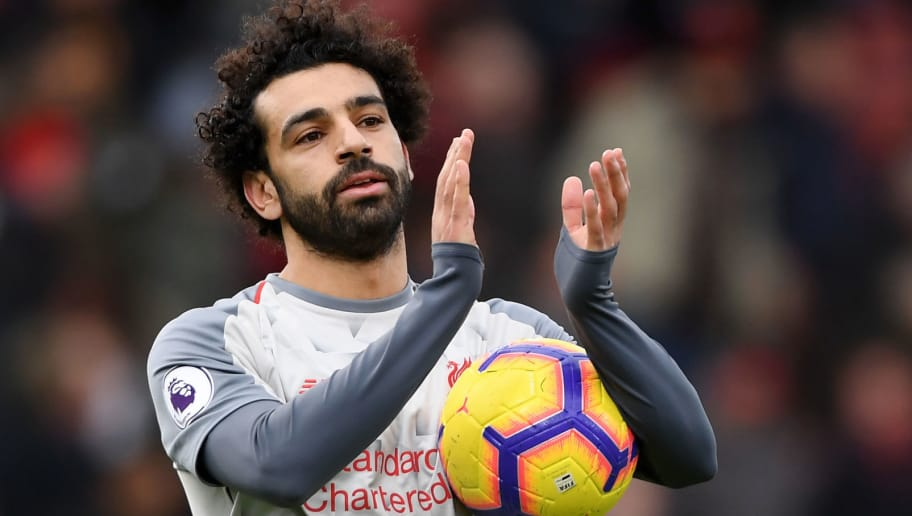 BOURNEMOUTH, ENGLAND - DECEMBER 08:  Mohamed Salah of Liverpool collects the match ball after scoring a hattrick and acknowledges the fans after the Premier League match between AFC Bournemouth and Liverpool FC at Vitality Stadium on December 8, 2018 in Bournemouth, United Kingdom.  (Photo by Mike Hewitt/Getty Images)