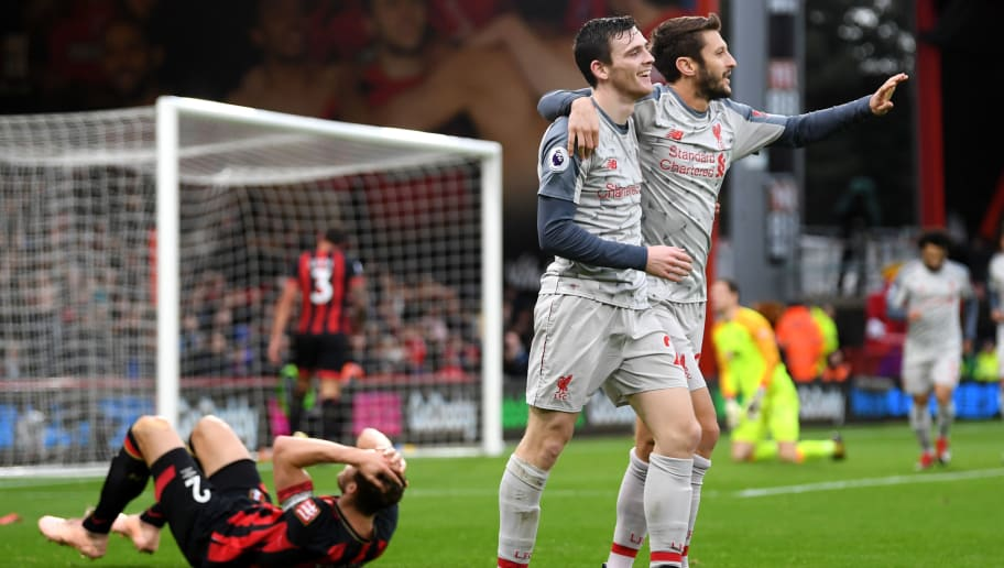 BOURNEMOUTH, ENGLAND - DECEMBER 08:  Steve Cook of AFC Bournemouth reacts to scoring a own goal for Liverpool's third goal of the game as Andy Robertson of Liverpool abd Adam Lallana of Liverpool celebrate during the Premier League match between AFC Bournemouth and Liverpool FC at Vitality Stadium on December 8, 2018 in Bournemouth, United Kingdom.  (Photo by Mike Hewitt/Getty Images)