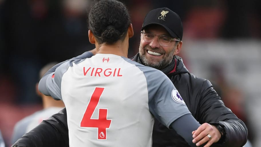 BOURNEMOUTH, ENGLAND - DECEMBER 08: Jurgen Klopp, Manager of Liverpool celebrates victory with Virgil van Dijk of Liverpool after the Premier League match between AFC Bournemouth and Liverpool FC at Vitality Stadium on December 8, 2018 in Bournemouth, United Kingdom.  (Photo by Mike Hewitt/Getty Images)