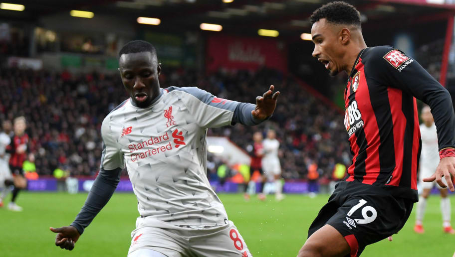 BOURNEMOUTH, ENGLAND - DECEMBER 08: Junior Stanislas of AFC Bournemouth is challenged by Naby Keita of Liverpool during the Premier League match between AFC Bournemouth and Liverpool FC at Vitality Stadium on December 8, 2018 in Bournemouth, United Kingdom.  (Photo by Mike Hewitt/Getty Images)