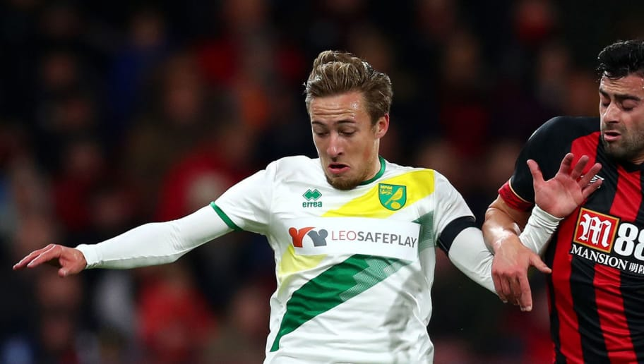 BOURNEMOUTH, ENGLAND - OCTOBER 30:  Felix Passlack of Norwich City and Diego Rico of AFC Bournemouth battle for the ball during the Carabao Cup Fourth Round match between AFC Bournemouth and Norwich City at Vitality Stadium on October 30, 2018 in Bournemouth, England.  (Photo by Clive Rose/Getty Images)