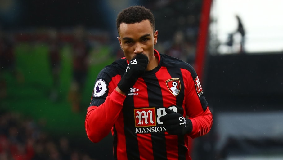 BOURNEMOUTH, ENGLAND - MARCH 11:  Junior Stanislas of AFC Bournemouth celebrates after scoring his sides first goal during the Premier League match between AFC Bournemouth and Tottenham Hotspur at Vitality Stadium on March 11, 2018 in Bournemouth, England.  (Photo by Clive Rose/Getty Images)