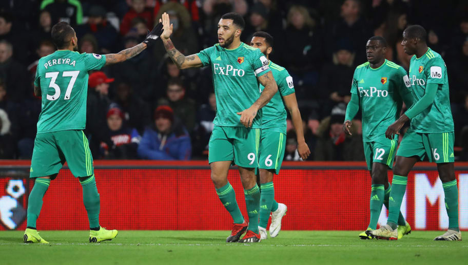 BOURNEMOUTH, ENGLAND - JANUARY 02:  Troy Deeney of Watford (9) celebrates as he scores his team's second goal with Roberto Pereyra (37) and team mates during the Premier League match between AFC Bournemouth and Watford FC at Vitality Stadium on January 2, 2019 in Bournemouth, United Kingdom.  (Photo by Dan Istitene/Getty Images)