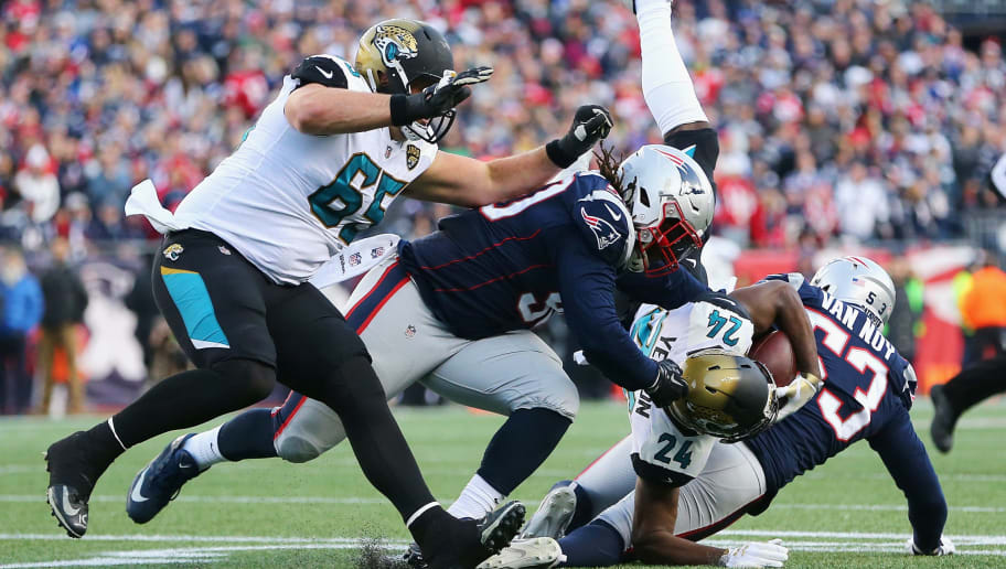 FOXBOROUGH, MA - JANUARY 21:  T.J. Yeldon #24 of the Jacksonville Jaguars is tackled after a catch in the first half  during the AFC Championship Game against the Jacksonville Jaguars at Gillette Stadium on January 21, 2018 in Foxborough, Massachusetts.  (Photo by Adam Glanzman/Getty Images)