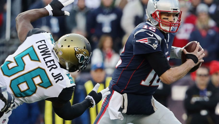 FOXBOROUGH, MA - JANUARY 21:  Tom Brady #12 of the New England Patriots is pursued by Dante Fowler Jr. #56 of the Jacksonville Jaguars in the first quarter during the AFC Championship Game at Gillette Stadium on January 21, 2018 in Foxborough, Massachusetts.  (Photo by Maddie Meyer/Getty Images)