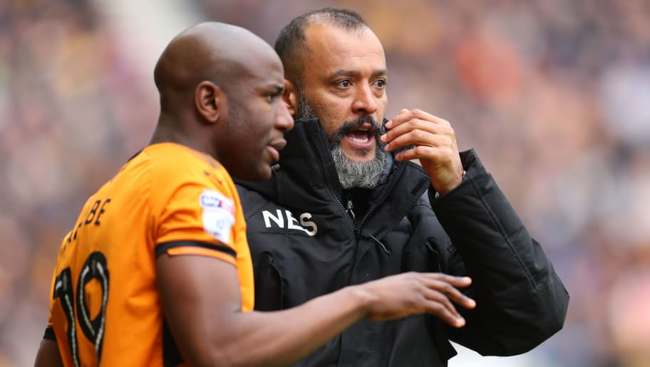 WOLVERHAMPTON, ENGLAND - APRIL 15: Nuno Espirito Santo manager of Wolverhampton Wanderers with Benik Afobe of Wolverhampton Wanderers during the Sky Bet Championship match between Wolverhampton Wanderers and Birmingham City at Molineux on April 15, 2018 in Wolverhampton, England. (Photo by Catherine Ivill/Getty Images)