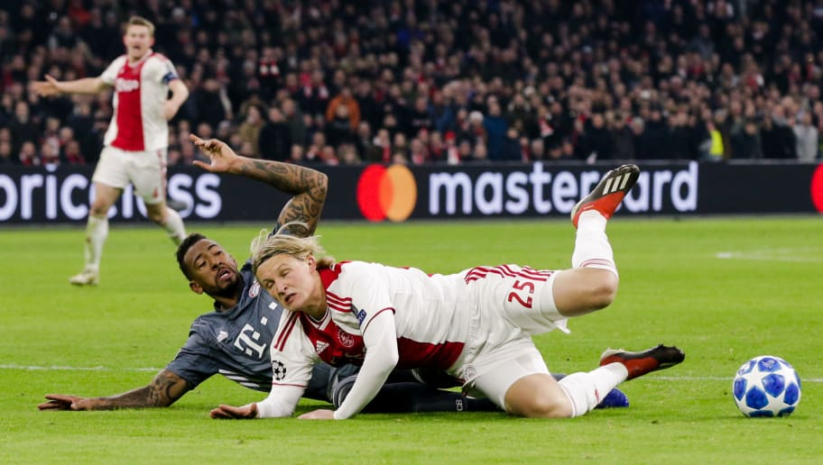 AMSTERDAM, NETHERLANDS - DECEMBER 12: (L-R) Jerome Boateng of Bayern Munchen, Kasper Dolberg of Ajax during the UEFA Champions League  match between Ajax v Bayern Munchen at the Johan Cruijff Arena on December 12, 2018 in Amsterdam Netherlands (Photo by Erwin Spek/Soccrates/Getty Images)