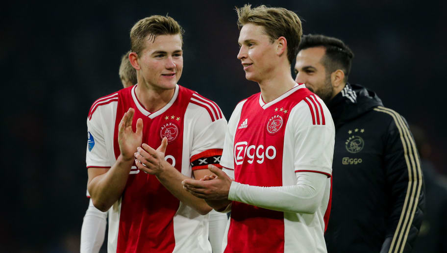 AMSTERDAM, NETHERLANDS - DECEMBER 16: (L-R) Matthijs de Ligt of Ajax, Frenkie de Jong of Ajax, celebrate the victory after the game during the Dutch Eredivisie  match between Ajax v De Graafschap at the Johan Cruijff Arena on December 16, 2018 in Amsterdam Netherlands (Photo by Erwin Spek/Soccrates/Getty Images)