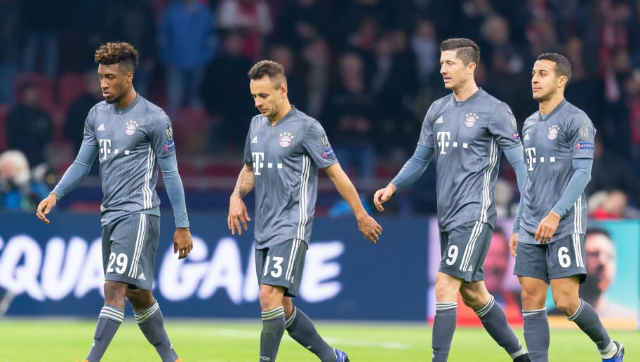AMSTERDAM, NETHERLANDS - DECEMBER 12: Kingsley Coman of Bayern Muenchen, Rafinha of Bayern Muenchen, Robert Lewandowski of Bayern Muenchen Thiago of Bayern Muenchen look dejected during the UEFA Champions League Group E match between Ajax and FC Bayern Muenchen at Johan Cruyff Arena on December 12, 2018 in Amsterdam, Netherlands. (Photo by TF-Images/TF-Images via Getty Images)