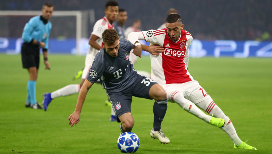 AMSTERDAM, NETHERLANDS - DECEMBER 12 Joshua Kimmich of Bayern Munich and Dani de Wit of Ajax  during the UEFA Champions League Group E match between Ajax and FC Bayern Muenchen at Johan Cruyff Arena on December 12, 2018 in Amsterdam, Netherlands.  (Photo by Dean Mouhtaropoulos/Getty Images)