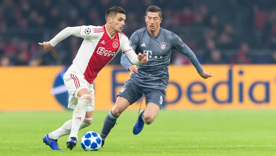 AMSTERDAM, NETHERLANDS - DECEMBER 12: Dusan Tadic of Ajax Amsterdam and Robert Lewandowski of Bayern Muenchen battle for the ball during the UEFA Champions League Group E match between Ajax and FC Bayern Muenchen at Johan Cruyff Arena on December 12, 2018 in Amsterdam, Netherlands. (Photo by TF-Images/TF-Images via Getty Images)