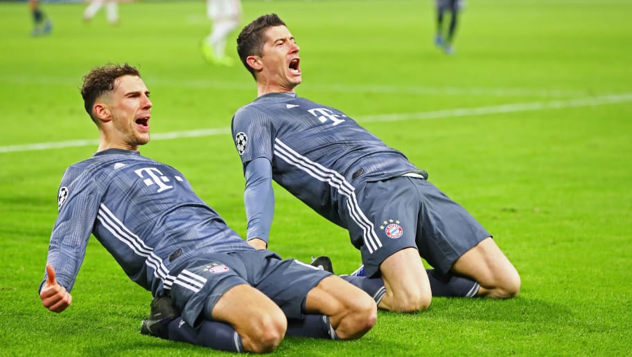 AMSTERDAM, NETHERLANDS - DECEMBER 12:  Robert Lewandowski (R) of Bayern Muenchen celebrates scoring his teams second goal of the game with Leon Goretzka during the UEFA Champions League Group E match between Ajax and FC Bayern Munich at Johan Cruyff Arena on December 12, 2018 in Amsterdam, Netherlands.  (Photo by Dean Mouhtaropoulos/Getty Images)