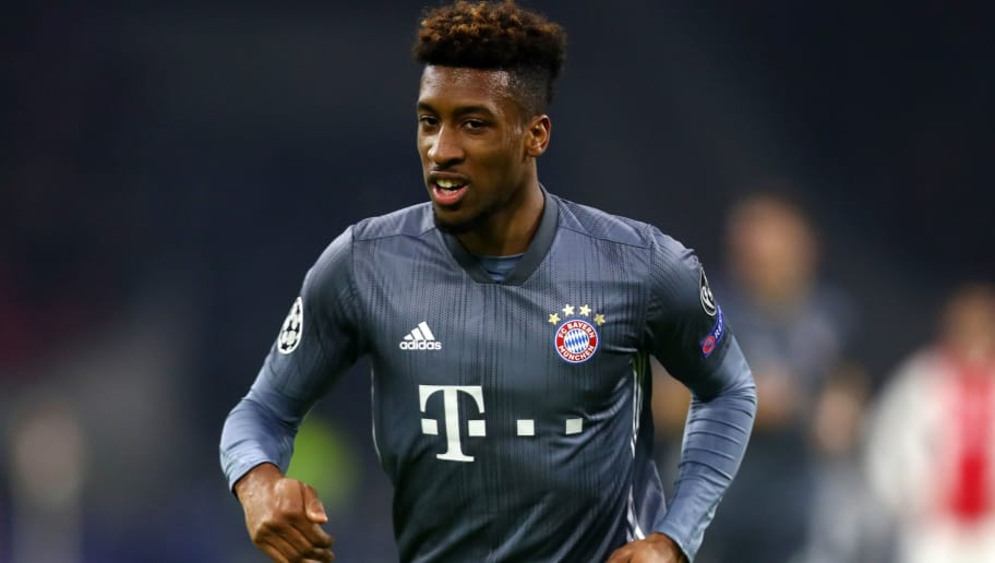 AMSTERDAM, NETHERLANDS - DECEMBER 12: Kingsley Coman of Bayern Munich celebrates after scoring his sides third goal during the UEFA Champions League Group E match between Ajax and FC Bayern Muenchen at Johan Cruyff Arena on December 12, 2018 in Amsterdam, Netherlands.  (Photo by Dean Mouhtaropoulos/Getty Images)
