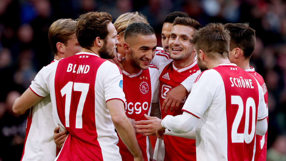 AMSTERDAM, NETHERLANDS - OCTOBER 28: Hakim Ziyech of Ajax celebrates 2-0 with Frenkie de Jong of Ajax, Daley Blind of Ajax, Dusan Tadic of Ajax, Kasper Dolberg of Ajax, Noussair Mazraoui of Ajax, Lasse Schone of Ajax, Nicolas Tagliafico of Ajax  during the Dutch Eredivisie  match between Ajax v Feyenoord at the Johan Cruijff Arena on October 28, 2018 in Amsterdam Netherlands (Photo by Soccrates/Getty Images)