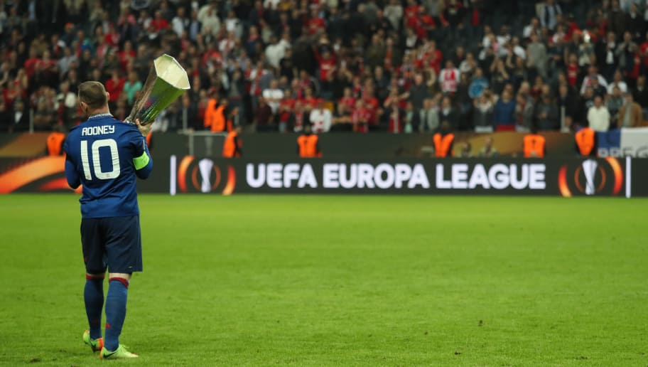 STOCKHOLM, SWEDEN - MAY 24:  Wayne Rooney of Manchester United lholds the trophy at the end of the UEFA Europa League Final between Ajax and Manchester United at Friends Arena on May 24, 2017 in Stockholm, Sweden.  (Photo by Matthew Ashton - AMA/Getty Images)