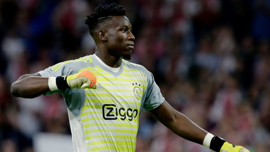 AMSTERDAM, NETHERLANDS - AUGUST 14: Andre Onana of Ajax celebrates the victory  during the UEFA Champions League  match between Ajax v Standard Luik at the Johan Cruijff Arena on August 14, 2018 in Amsterdam Netherlands (Photo by Erwin Spek/Soccrates/Getty Images)